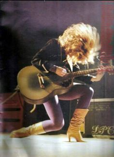 Nancy Wilson - guitarist, co-leader (with her sister Ann) and second vocalist in hard rocking Seattle group, Heart. The band has had several periods of triumph since the mid-seventies and remain the standard for female fronted bands.