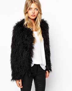 Fuzzy coats and jackets are so popular this season. You'll find me mixing fluffy items with my minimal wardrobe to twist up my looks. Find it here: http://asos.do/HOWV8K