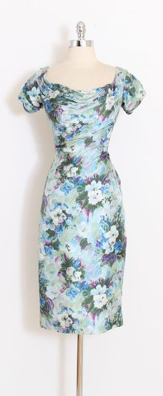 ➳ vintage 1950s dress * gorgeous Ceil Chapman dress * lovely blue floral print silk * acetate lining * signature ruching * metal back zipper condition | lining is shattering at armpits. not visible when worn. fits like medium length 43 bodice 16 bust 38 waist 28 hips 38 ➳ shop http://www.etsy.com/shop/millstreetvintage?ref=si_shop ➳ shop policies http://www.etsy.com/shop/millstreetvintage/policy twitter | MillStVintage facebook | millstre...