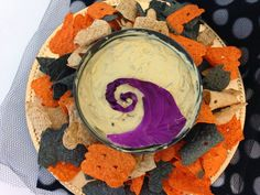 The Nightmare Before Christmas graveyard dip. Onion dip, cut out red cabbage, halloween tortilla chips
