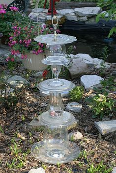 This is made from recycled glass pieces. Looks pretty in the sunlight in a flower garden.