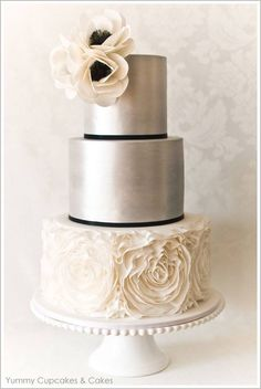 This is one of my favorite, perfect for black and white weddings with a hint of pewter. I call it the anemone cake, because of the two delicate cake flowers at the top, as well as the detail within the bottom tier. This cake is perfect for smaller more intimate weddings