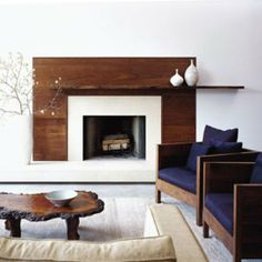10 Fireplace Surrounds with Beautiful Wooden Wall Panels | Apartment Therapy - I like this asymmetric mantel, and love the coffee table