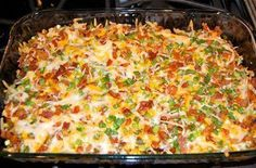 loaded baked potato & chicken caserole  lbschicken breasts, cubed  8 potatoes, cubed  1/3 cupolive oil 1 1/2 teaspoonssalt 1 tablespoonfresh ground pepper 1 tablespoonpaprika 2 tablespoonsgarlic powder 6 tablespoons hot sauce  2 cup cheddar cheese, shredded  1 cup bacon, crumbled  1 cup green onion, diced
