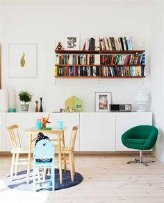 Dining area with a cool green chair