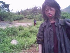 This starving girl was searching for food to eat. A few weeks after this photo was taken, she was found dead in a field. Inside North Korea, Life In North Korea, Chinese Propaganda Posters, Korea News, Korean People, Korean Wave, Save The Children, Pictures Of People, Persecution