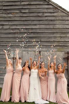 Fun confetti moment with the bridesmaids, love the energy in this shot! | Ilene Squires Photography