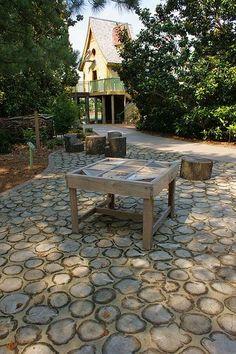 Memphis Botanic Garden (tree rounds in concrete) (This flooring idea is indoors at the museum in Nashville. Beautiful)