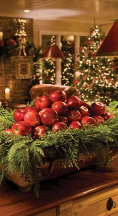 As simple & inexpensive way to bring some rustic Christmas cheer to your table - a bowl full of apples and evergreen tree trimmings. Primitive Christmas, Noel Christmas, Country Christmas, Winter Christmas, All Things Christmas, Natural Christmas, Christmas Colors, Simple Christmas, Beautiful Christmas