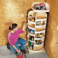 "simple rotating shelves for a garage or workshop corner (or craft room). Strips of 3"" vinyl base attached to the shelf edges keep items secure. (You don't want little objects falling off in back!) make them more like bins. Secured by a lazy susan rotator at top as well as bottom, so it won't tip.."