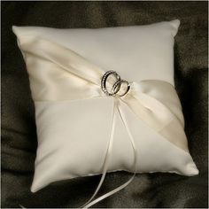 WeddingDepot.com ~ Ring Bearer Pillow - With This Ring - Ivory ~ This elegant ring pillow is covered in soft matte satin. The front of the pillow is accented with a diagonal ribbon gathered by a pair of wedding rings with crystals.