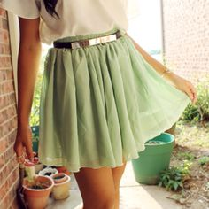 A perfect mint green skirt for a fresh look. Pair it with a cropped moto jacket for a totally chic tough girl vibe.