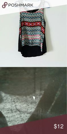 Forever 21 tribal print tank Forever 21 Tank Top. Does have a small hole in back. This tank top is slightly longer in the back than it is in the front. Please see picture number 2 for hole. Willing to give discount due to hole Forever 21 Tops Tank Tops