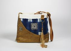 Bucket bag in handwoven and indigo dyed cotton from Mali, paired with distressed leather. #nancynewmantextiles