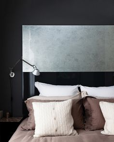 opulent bedside shot with dark walls and variety of textures by Nathalie Priem interiors photographer