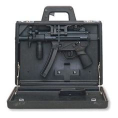 """The Heckler & Koch MP5K """"Koffer"""" Special-Ops Edition.  Check the trigger in the handhold!"""