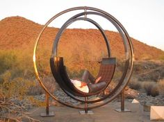 Here's a way to enjoy a 360-degree view. Part swivel chair, part hammock, this gyroscope-recalling outdoor lounge chair lets users rotate to get the best view, like a desert sunset, or even to avoid intense sunshine altogether.   The chair, called Etazin, is made of three solid steel rings. The outermost ring is stationary, creating a framework so the two inner rings can spin. A curved, padded lounge chair sits on the innermost ring.  Etazin - Modern - Other - Phoenix - Phoenix Design…