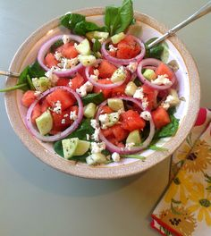 watermelon,cucumbers,red onion,baby spinich,1 tbs lime juice,feta cheese and dressing = mmmm