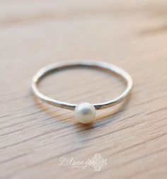 tiny pearl  tiny pearl ring. slim silver band. by lilpengee, $28.00