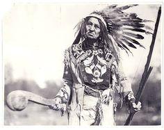 IROQUOIS MOHAWK Elder Man wearing headdress & holding club, 1932