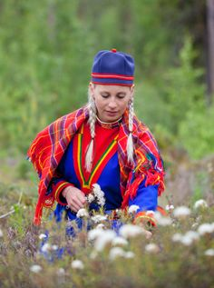 A young woman from Jokkmokk in Swedish Lapland. The tradition is to pick seven different kinds of flowers to keep under your pillow on Midsummer night. Then you will see your lover in your dreams.