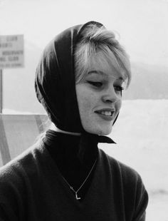 Brigitte Bardot headscarf & cat eyes. cover cold little ears while still looking sassy.  crucifix necklace is a nice touch.