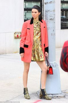 Kendall Jenner gels down her locks and poses up a storm in New York #dailymail