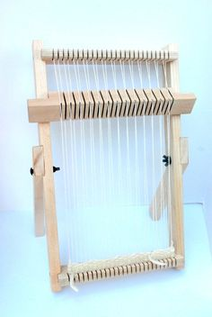 """Beginners weaving loom! This loom was designed with the beginner in mind. It has legs that lock into place, but are easy to take off or collapse for traveling. It has notched pegs to help keep your warp in place and it has a rotating heddle! This is a great tool to make weaving quick and easy.  This listing is for the loom and heddle with a weaving instruction book.  The loom measures 12"""" x 16"""". The woven area is approximately 10"""" x 12"""", the heddle is warped to the loom and the weaving…"""