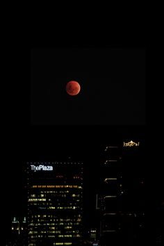 Super blood moon over the Jakarta city skyline