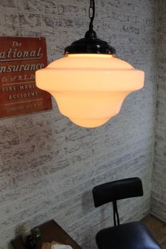 warm glow of the Schoolhouse Shade Pendant Light