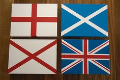 Set of four flag canvases I painted for my Son's bedroom.  St George's Cross, St Patrick's Cross and St Andrew's Cross....all making up the Union Jack.