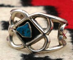 Circa 1960-70's, Navajo sand cast bracelet with a unique shaped turquoise stone from the Kingman Mine in Arizona