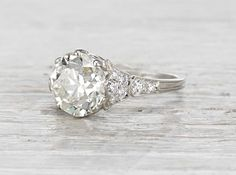 Vintage Edwardian engagement ring made in platinum and centered with a 3.93 carat GIA certified old European cut diamond with M color and VS1 clarity. Circa 1910. This ring is a stunner! The center di