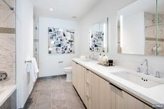 Loving this beautiful light bathroom design. Nothing like white countertops to give a bathroom that clean look. 😍  #forevermarkcabinetry #fabuwood #nycdesigners #worldofinteriors #kitchenrenovation #kitchenremodel #decoradora #kitchentransformation #kitchenstuff #kitchentiles #countrykitchen  #bathrooms #cabinets #bathroomtiles #subwaytiles #backsplash #kitchenbeautiful #marthastewartliving #homedecorationideas #kitchendesign #designersofinsta #interiorstyling #homedecorideas #bathroomgoals