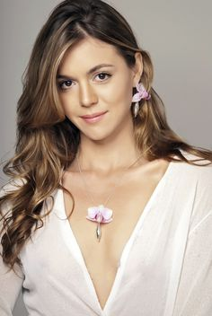 Designer and Creator of Fleurings ... actress Samantha Lockwood wearing her mini-vase jewelry pieces. Same photo as seen in the Hawaiian Airlines  Hana Hou Magazine