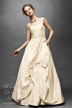 Anthropologie Wedding Dress - we love the gathering and bodice of this gown! So graceful