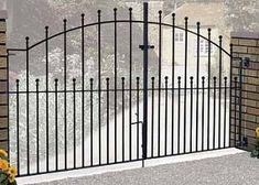 Manor Metal Driveway Gates feature a solid steel construction, arch top and ball shaped finials to create a traditional gate design that will blend with any residential property