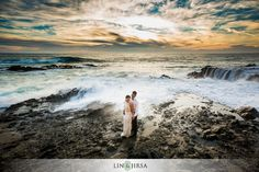 I love the sky and all the colors captured and the waves crashing against the rocks and how the couple is standing in the middle (basically love everything about this picture)