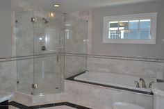 Traditional Full Bathroom with frameless showerdoor, High ceiling, Complex marble counters, complex marble tile floors