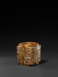 A Neolithic Russet-Brown and Yellow Jade Cong Liangzhu Culture, circa 3300–2250 B.C.