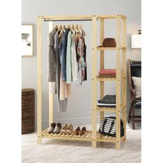 Whitmor's Slat Wood Wardrobe adds additional space to your bedroom or closet while also showcasing the beauty of wood built products. The unit features lacquer finished natural wood with a metal hangi Pallet Wardrobe, Diy Wardrobe, Open Wardrobe, Pallet Closet, Wardrobe Design, Wardrobe Ideas, Portable Closet, Diy Home Decor, Room Decor