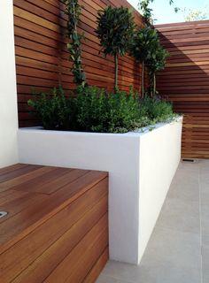 small modern minimalist low maintenance garden dulwich london block wall bench hardwood screen trellis privacy screen architectural planting (19)