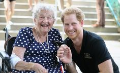 Harry seemed thrilled to chat with the delighted pensioner as the pair clutched hands outs...