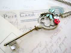 Key Necklace - Key with dragonfly and flower. $20.00, via Etsy.