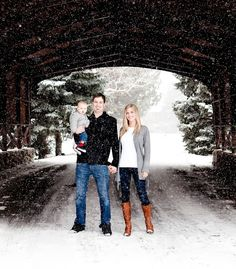 winter family photo in covered bridge