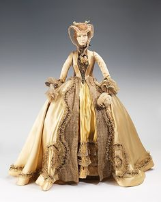 """""""1733 Doll""""  Jean Bader (French)  Designer: Domins (French) Designer: Marcel Maggy (French) Designer: Sack (French) Date: 1949 Culture: French Medium: metal, plaster, hair, silk, glass, pearl beads, fur Dimensions: 30 1/2 x 17 1/2 in. (77.5 x 44.5 cm) Credit Line: Brooklyn Museum Costume Collection at The Metropolitan Museum of Art, Gift of the Brooklyn Museum, 2009; Gift of Syndicat de la Couture de Paris, 1949"""