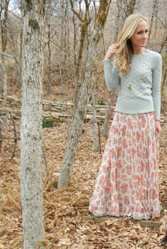 Early Fall dressing. Add sweaters to your summer skirt wardrobe. Take little hint of color from your summer skirt and use that color for your sweater. The summer skirt has a hint of gray and that is why this outfit look put together.