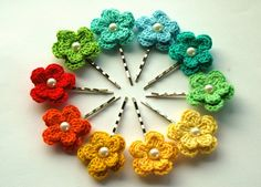 crochet flowers on bobby pins ... pearl centers ... great colors ...