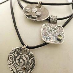 Fine silver Pendants I made using precious metal clay.