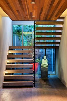 Parliament by Werner Construction in North Vancouver, Canada These floating, chunky wooden stairs are absolutely gorgeous… and very Zen, so Buddha is a perfect fit.